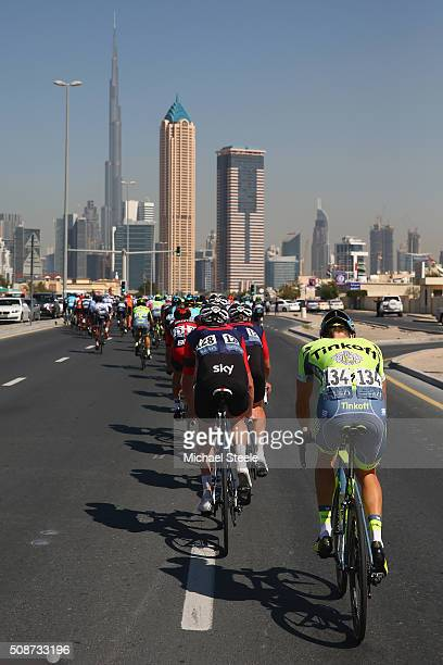 Michael Gogl of Austria and Tinkoff brings up the rear of the peloton as the Burj Khalifa looms ahead during the Business Bay Stage Four of the Tour...