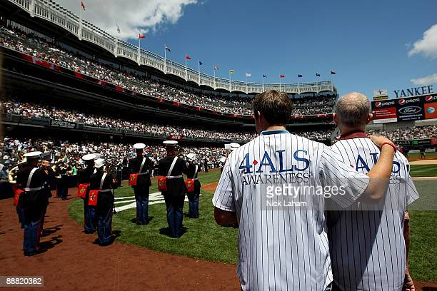 Michael Goldsmith a sufferer of Amyotrophic Lateral Sclerosis often referred to as 'Lou Gehrig's Disease' stands with son Austin prior to the game...