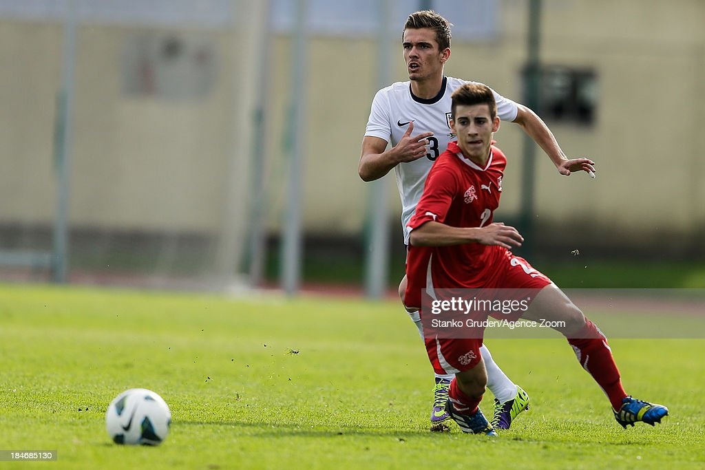 Michael Goncalves of Switzerland and Harry Toffolo of England during the UEFA U19 Championships Qualifier between England and Switzerland, on October 15, 2013 in Ptuj, Slovenia.