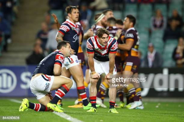 Michael Gordon and Connor Watson of the Roosters looks dejected after a Broncos try during the NRL Qualifying Final match between the Sydney Roosters...