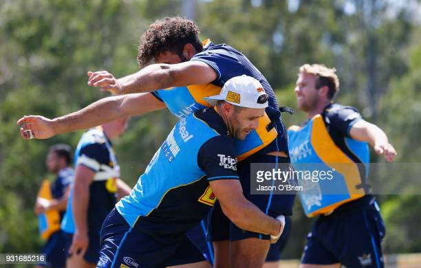 Michael Gordon and Tyrone RobertsDavis perform tackling drills during a Gold Coast Titans NRL training session at Parkwood on March 14 2018 in Gold...