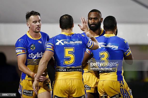 Michael Gordon of the Eels celebrates with teammate Semi Radradra after a try during the round 26 NRL match between the New Zealand Warriors and the...