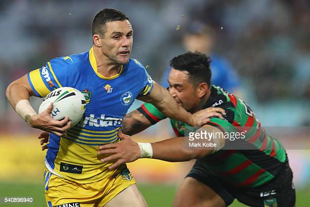 Michael Gordon of the Eels fends away John Sutton of the Rabbitohs during the round 15 NRL match between the South Sydney Rabbitohs and the...