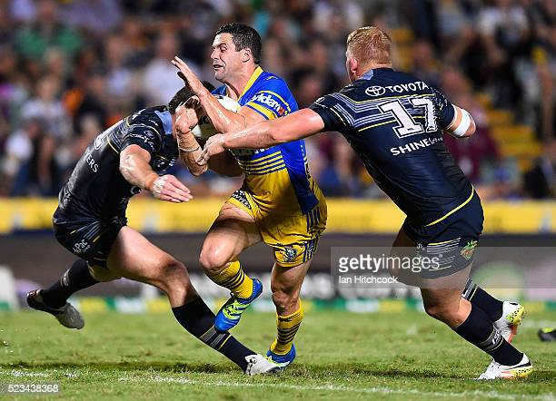 Michael Gordon of the Eels is tackled by Lachlan Coote and Ben Hannant of the Cowboys during the round eight NRL match between the North Queensland...