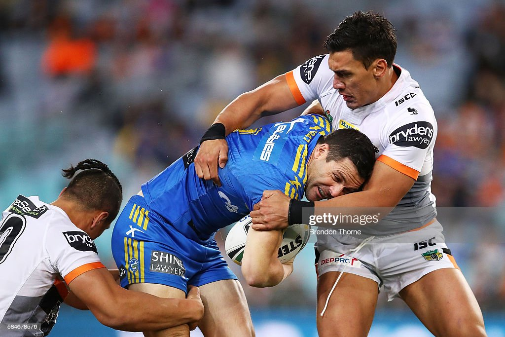 Michael Gordon of the Eels is tackled by the Tigers defence during the round 21 NRL match between the Parramatta Eels and the Wests Tigers at ANZ Stadium on July 30, 2016 in Sydney, Australia.
