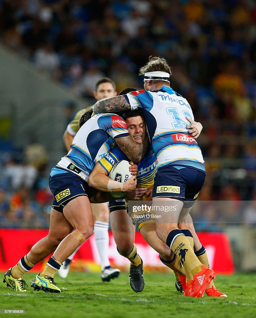 Michael Gordon of the Eels is tackled by the Titans defence during the round 20 NRL match between the Gold Coast Titans and the Parramatta Eels at Cbus Super Stadium on July 23, 2016 in Gold Coast, Australia.