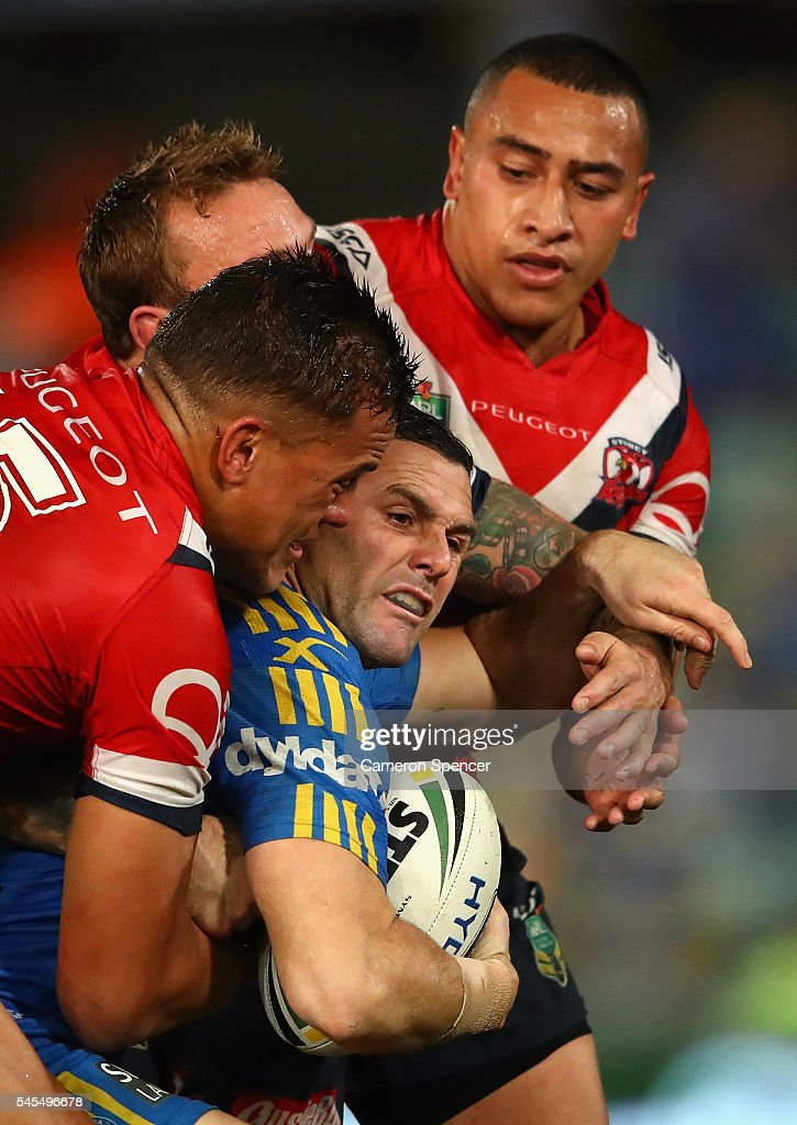 Michael Gordon of the Eels is tackled during the round 18 NRL match between the Parramatta Eels and the Sydney Roosters at Pirtek Stadium on July 8, 2016 in Sydney, Australia.