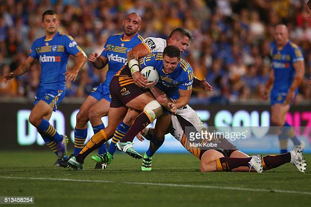 Michael Gordon of the Eels is tackled during the round one NRL match between the Parramatta Eels and the Brisbane Broncos at Pirtek Stadium on March...