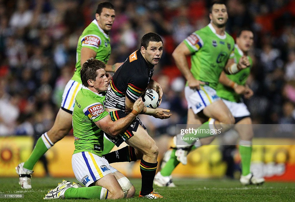 Michael Gordon of the Panthers is tackled by Josh McCrone of the Raiders during the round five NRL match between the Penrith Panthers and the Canberra Raiders at Centrebet Stadium on April 9, 2011 in Sydney, Australia.