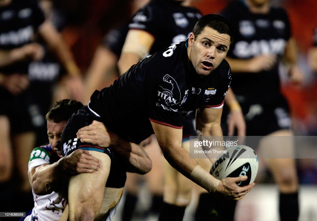 Michael Gordon of the Panthers is tackled by the Knights defence during the round 13 NRL match between the Penrith Panthers and the Newcastle Knights at CUA Stadium on June 5, 2010 in Sydney, Australia.