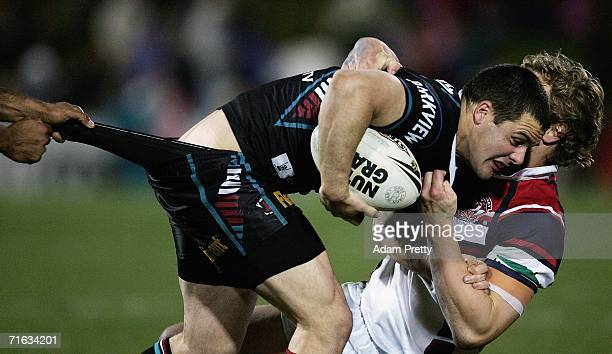 Michael Gordon of the Panthers is tackled during the round 23 NRL match between the Penrith Panthers and the Sydney Roosters at CUA Stadium on August...