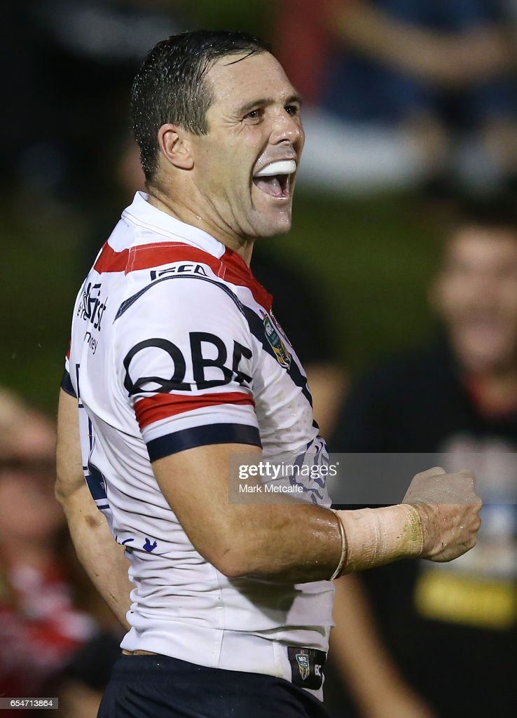Michael Gordon of the Roosters celebrates scoring a try during the round three NRL match between the Penrith Panthers and the Sydney Roosters at Pepper Stadium on March 18, 2017 in Sydney, Australia.