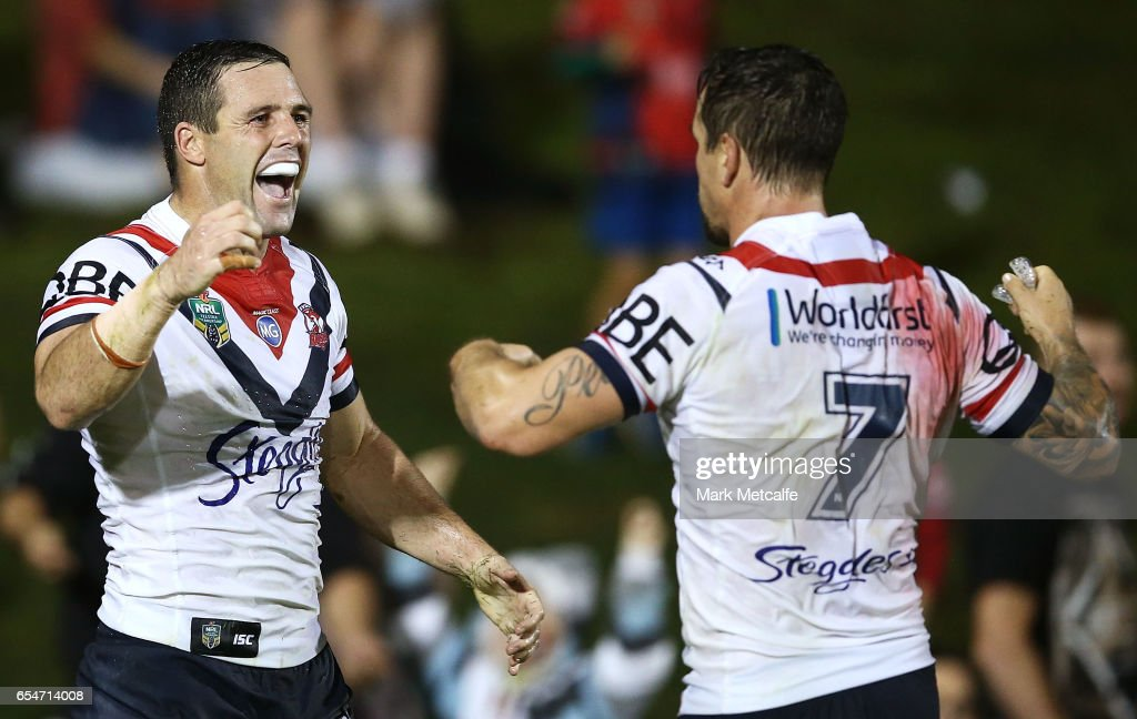 Michael Gordon of the Roosters celebrates scoring a try with team mate Mitchell Pearce during the round three NRL match between the Penrith Panthers and the Sydney Roosters at Pepper Stadium on March 18, 2017 in Sydney, Australia.