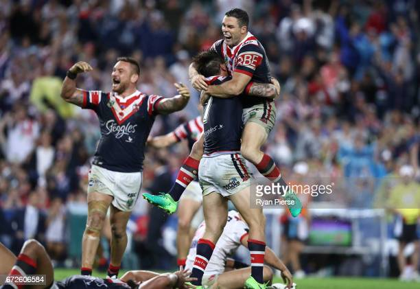 Michael Gordon of the Roosters celebrates with Mitchell Pearce of the Roosters after he kicked a field goal in Golden Point during the round eight...