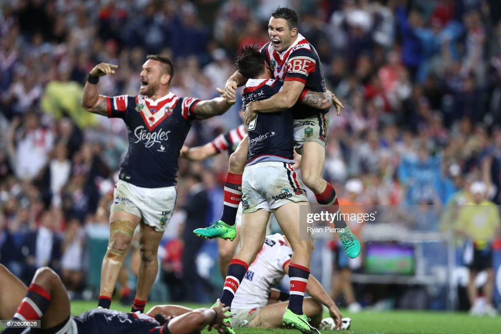 Michael Gordon of the Roosters celebrates with Mitchell Pearce of the Roosters after he kicked a field goal in Golden Point during the round eight NRL match between the Sydney Roosters and the St George Illawarra Dragons at Allianz Stadium on April 25, 2017 in Sydney, Australia.