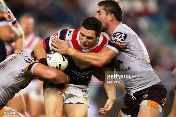 Michael Gordon of the Roosters is tackled during the round 13 NRL match between the Sydney Roosters and the Brisbane Broncos at Allianz Stadium on...