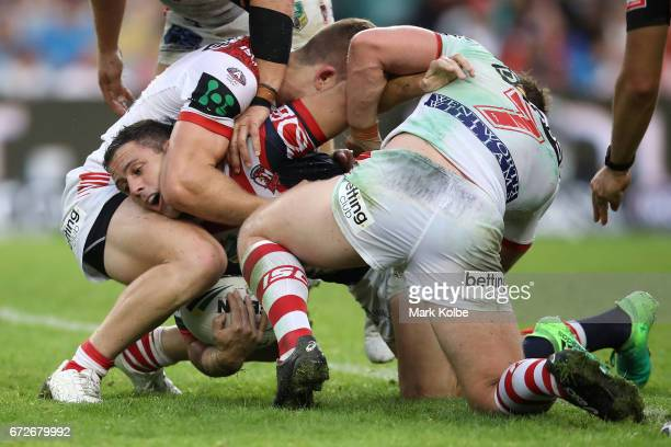 Michael Gordon of the Roosters is tackled during the round eight NRL match between the Sydney Roosters and the St George Illawarra Dragons at Allianz...