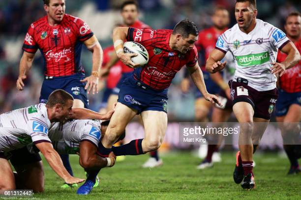 Michael Gordon of the Roosters is tackled during the round five NRL match between the Sydney Roosters and the Manly Sea Eagles at Allianz Stadium on...
