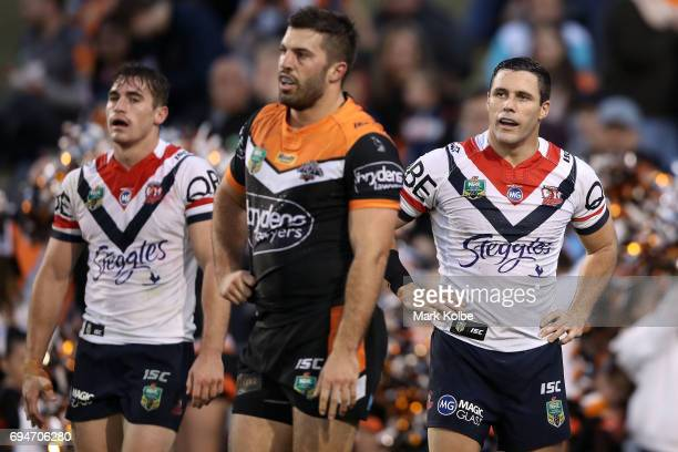 Michael Gordon of the Roosters looks dejected after James Tedesco of the Tigers scored a try during the round 14 NRL match between between the Wests...