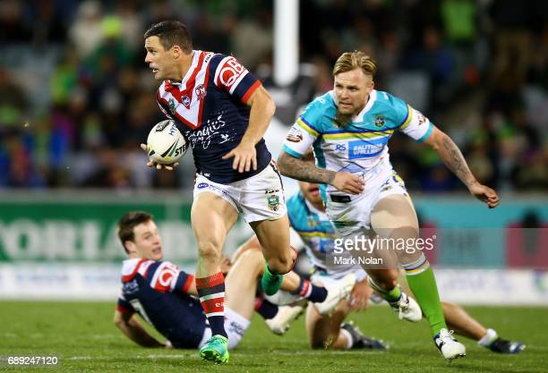 Michael Gordon of the Roosters makes a line break during the round 12 NRL match between the Canberra Raiders and the Sydney Roostrers at GIO Stadium...