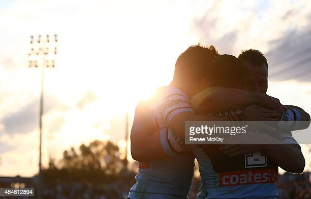 Michael Gordon of the Sharks celebrates his try with Luke Lewis and Jack Bird during the round 24 NRL match between the Cronulla Sharks and the Wests...