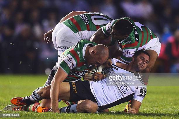 Michael Gordon of the Sharks is tackled during the round 11 NRL match between the Cronulla-Sutherland Sharks and the South Sydney Rabbitohs at...