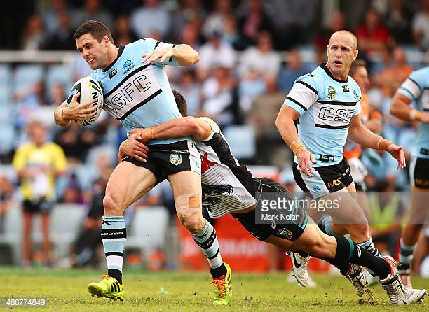 Michael Gordon of the Sharks is tackled during the round 8 NRL match between the CronullaSutherland Sharks and the Penrith Panthers at Remondis...