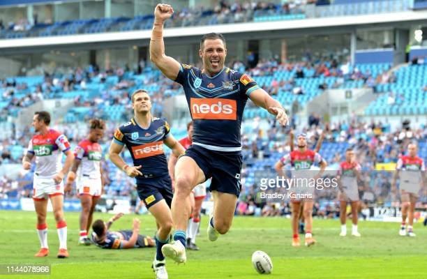 Michael Gordon of the Titans celebrates scoring a try during the round 6 NRL match between the Titans and the Knights at Cbus Super Stadium on April...