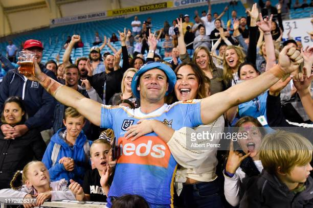 Michael Gordon of the Titans celebrates with wife and fans after playing his last game during the round 25 NRL match between the Gold Coast Titans...
