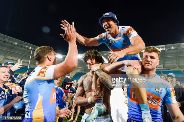 Michael Gordon of the Titans is lifted off the field after playing his last game during the round 25 NRL match between the Gold Coast Titans and the...