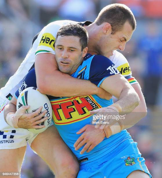 Michael Gordon of the Titans is tackled by Isaac Yeo of the Panthers during the round six NRL match between the Penrith Panthers and the Gold Coast...