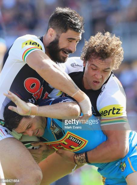 Michael Gordon of the Titans is tackled by James Tamou and James FisherHarris of the Panthers during the round six NRL match between the Penrith...
