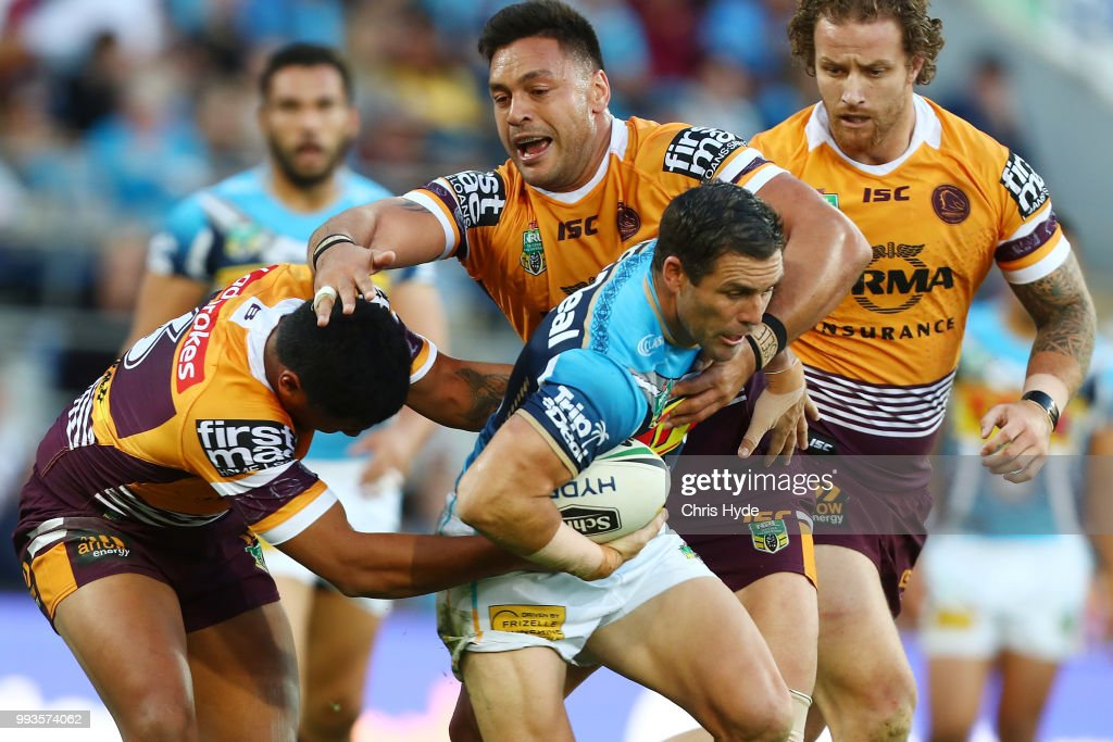 Michael Gordon of the Titans is tackled during the round 17 NRL match between the Gold Coast Titans and the Brisbane Broncos at Cbus Super Stadium on July 8, 2018 in Gold Coast, Australia.