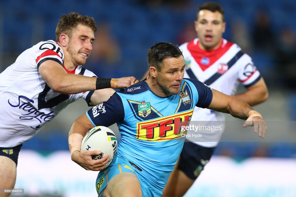 Michael Gordon of the Titans is tackled during the round 18 NRL match between the Gold Coast Titans and the Sydney Roosters at Cbus Super Stadium on July 15, 2018 in Gold Coast, Australia.