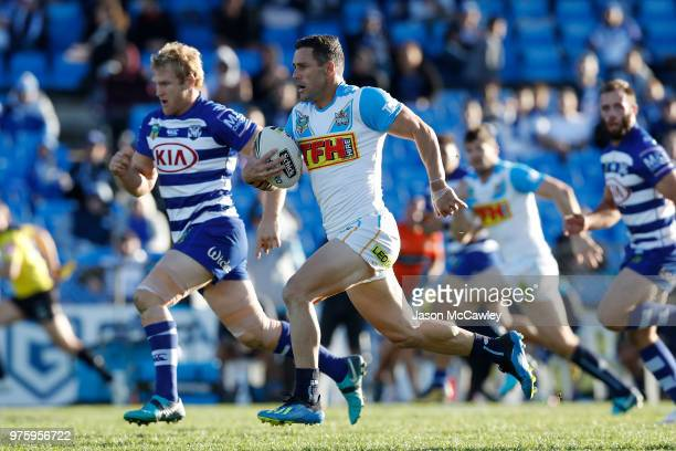 Michael Gordon of the Titans makes a break during the round 15 NRL match between the Canterbury Bulldogs and the Gold Coast Titans at Belmore Sports...