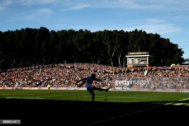Michael Gordon of the Titans takes a conversion attempt during the round 16 NRL match between the Wests Tigers and the Gold Coast Titans at...