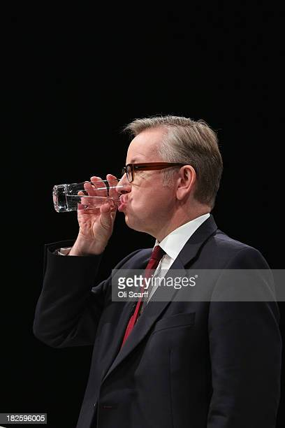 Michael Gove the Secretary of State for Education takes a drink as he delivers his speech in the Main Hall of Manchester Central on the third day and...
