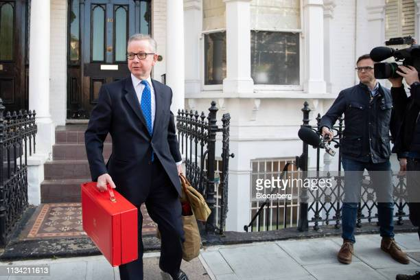 Michael Gove UK environment secretary carries his red dispatch box as he departs from his home in London UK on Monday April 1 2019 Complicating the...