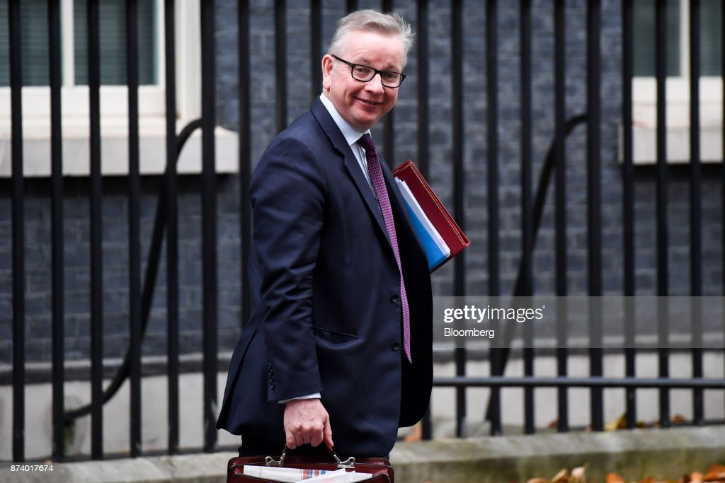 Michael Gove, U.K. environment secretary, leaves following a cabinet meeting at number 10 Downing Street in London, U.K., on Tuesday, Nov. 14, 2017. Analysts are more optimistic than the U.K. government that an agreement will be reached with the European Union next month to move Brexit talks on to trade even as Theresa Mays political troubles continue to weigh on the countrys beleaguered currency. Photographer: Chris J. Ratcliffe/Bloomberg via Getty Images