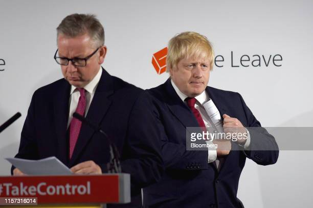 Michael Gove UK justice secretary left prepares to speak as Boris Johnson former mayor of London listens during a news conference at the Vote Leave...