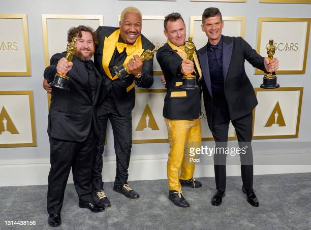 "Michael Govier and Will McCormack , winners of Best Animated Short Film for ""If Anything Happens I Love You"", pose with Travon Free and Martin..."