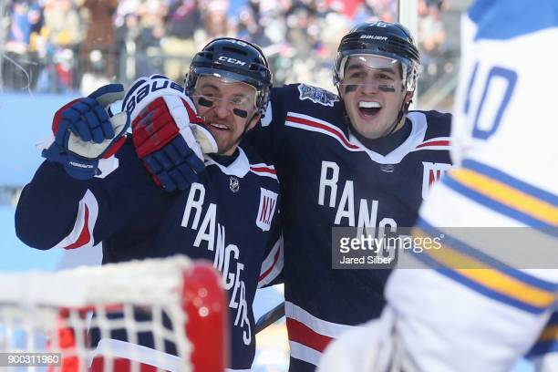 Michael Grabner and Brady Skjei of the New York Rangers celebrate Grabner's first period goal against the Buffalo Sabres during the 2018 Bridgestone...