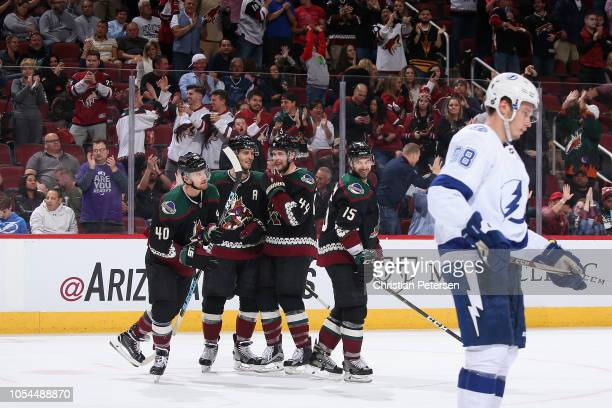 Michael Grabner Niklas Hjalmarsson Kevin Connauton and Brad Richardson of the Arizona Coyotes celebrate after Grabner scored a shorthanded goal...