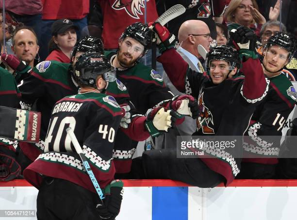 Michael Grabner of the Arizona Coyotes celebrates a second period goal with teammates Brendan Perlini and Vinnie Hinostroza against the Tampa Bay...