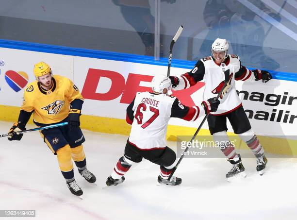Michael Grabner of the Arizona Coyotes celebrates his short-handed goal at 16:25 of the second period against the Nashville Predators and is joined...