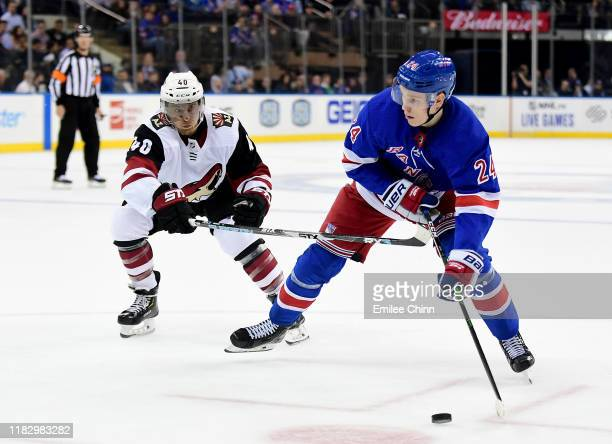 Michael Grabner of the Arizona Coyotes watches as Kaapo Kakko of the New York Rangers looks to make a pass during their game at Madison Square Garden...