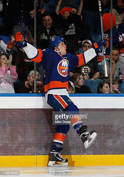 Michael Grabner of the New York Islanders celebrates his third period goal in a game against the Boston Bruins on March 11, 2011 at Nassau Coliseum...