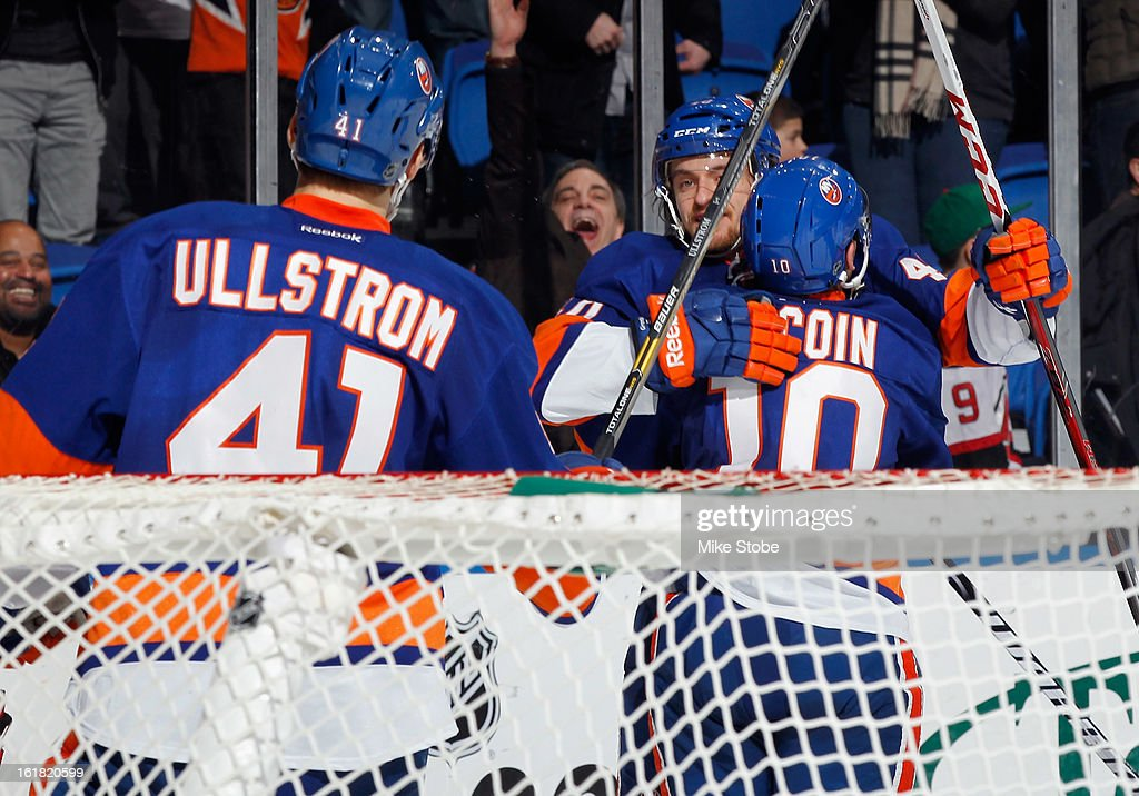 Michael Grabner #40 of the New York Islanders celebrates with his teamates after scoring a 3rd period goal against the New Jersey Devils at Nassau Veterans Memorial Coliseum on February 16, 2013 in Uniondale, New York. The Islanders defeated the Devils 5-1.