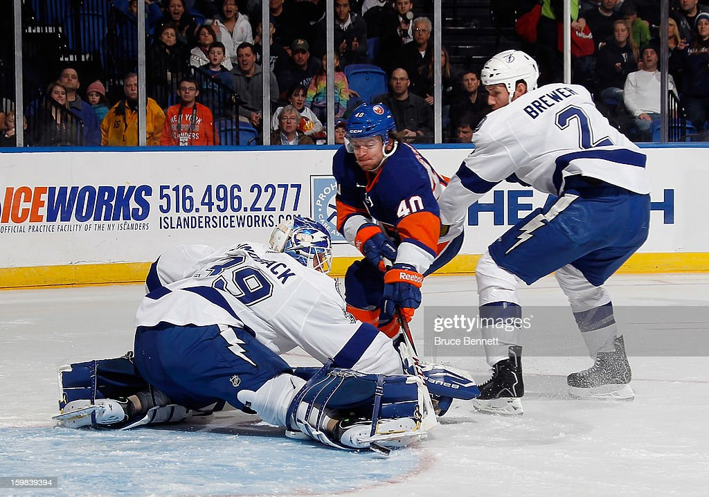 Michael Grabner #40 of the New York Islanders scores at 6:50 of the second period against Anders Lindback #39 of the Tampa Bay Lightning at the Nassau Veterans Memorial Coliseum on January 21, 2013 in Uniondale, New York.