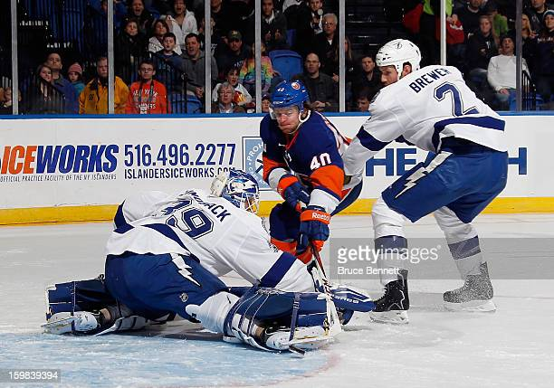 Michael Grabner of the New York Islanders scores at 650 of the second period against Anders Lindback of the Tampa Bay Lightning at the Nassau...